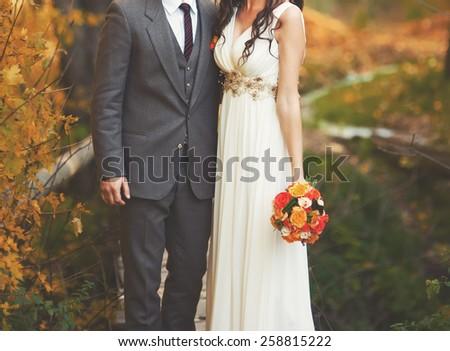 Wedding couple embracing.  Newlyweds in wonder forest.  - stock photo