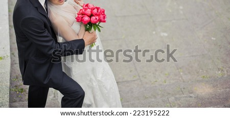 Wedding couple holding hands.