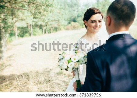 Wedding couple in forest.Groom and bride together. - stock photo