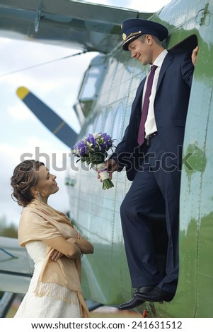 Wedding couple in love vintage aircraft - stock photo