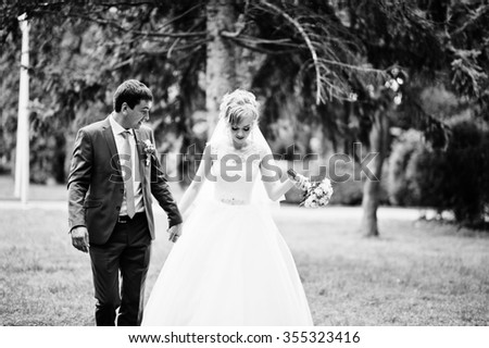 wedding couple in love walking in park - stock photo
