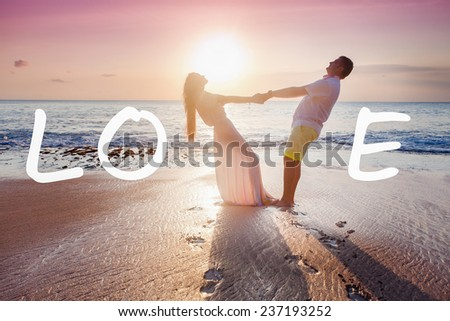 wedding couple just married near the beach with love text - stock photo