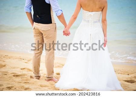 wedding couple on the beach - stock photo