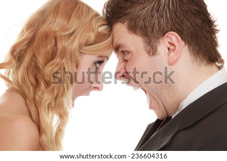Wedding couple relationship difficulties. Angry woman man yelling at each other. Portrait fury bride groom. Face to face. Negative bad communication human emotions facial expression.
