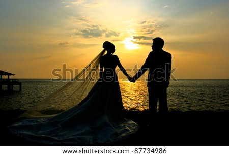 Wedding couple silhouette at sunset - stock photo