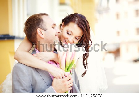 Wedding couple (soft focus, focus on eyes of bride) - stock photo