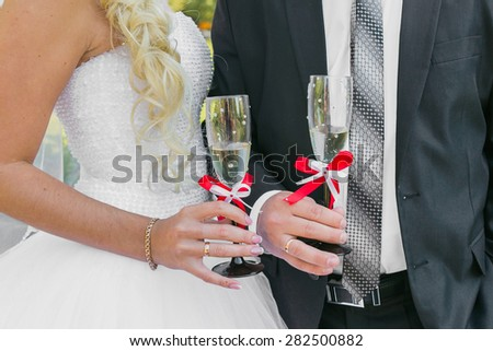 Wedding couple. The bride and groom with champagne glasses. - stock photo