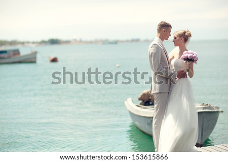 wedding couple together by the sea - stock photo