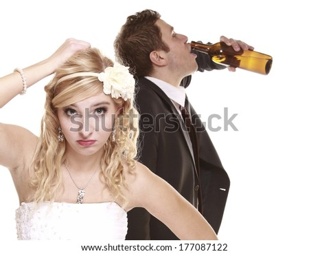 Wedding couple, unhappy bride with alcoholic drinking groom. Woman looking her future make a decision - violence alcoholism problems concept - stock photo