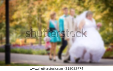 wedding couple walking in the park ,blurred wedding and love background