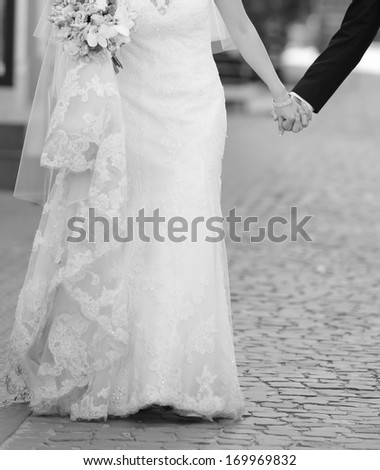 Wedding couple walking street, wedding fashion, black and white.