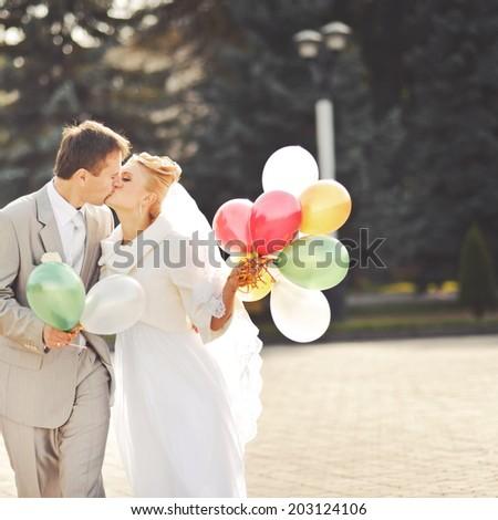 Wedding couple with balloons. - stock photo