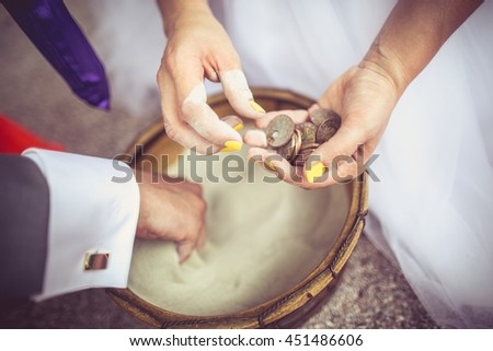 Wedding couple with money in hands