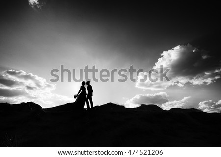 wedding couple with the sunset. Black and white image