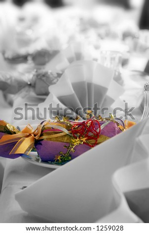 Wedding cracker or bonbon, color altered. Could be a birthday party. - stock photo