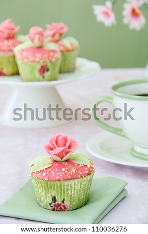 Wedding cupcakes with cup of coffee - stock photo