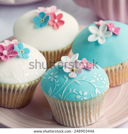 Wedding cupcakes with embossed fondant - stock photo