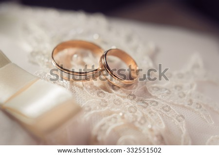 Wedding cushion with rings - stock photo