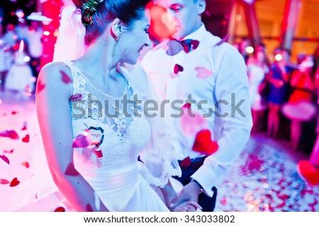 Wedding dance in restaurant with varioius lights and smoke - stock photo
