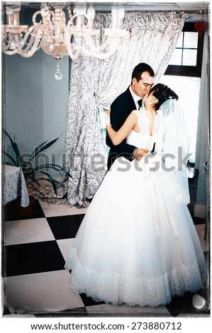 Wedding dance of charming bride and groom on their wedding celebration in a luxurious restaurant.