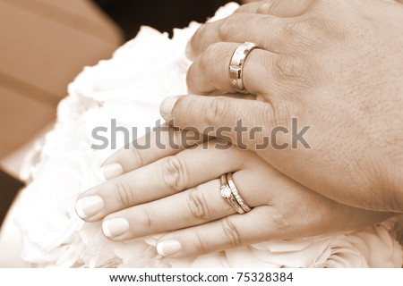 Wedding Day Bride and Grooms hands With Rings - stock photo