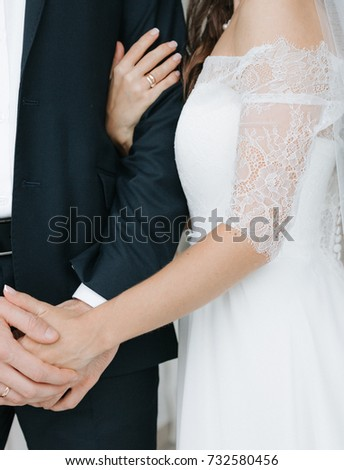 Wedding day. Concept. The bride hugs her fiancé.