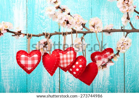 Wedding day love beautiful. Heart hanging on branch of tree on wooden background. - stock photo