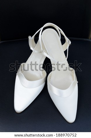 Wedding day pair of white shoes for bride closeup - stock photo