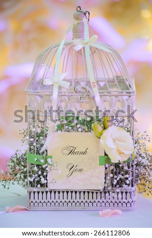 wedding decor birdcage at restaurant with all beauty and flowers - stock photo
