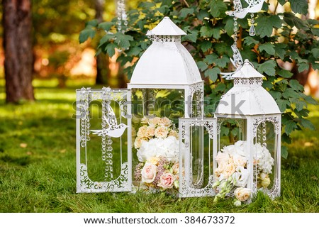 Wedding decor rustic style white vintage stock photo royalty free wedding decor in rustic styleo white vintage lamp with flowers inside standing on green junglespirit Image collections