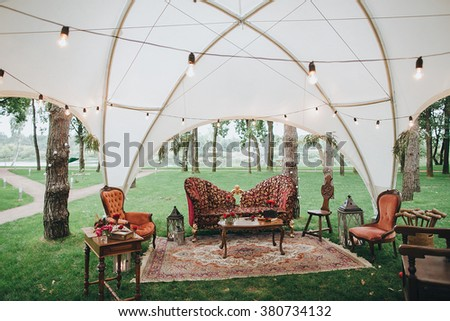 Wedding Decor On The Green Lawn In Forest Under A White Tent Lay