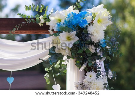 Wedding decor wedding arch decorated white stock photo edit now wedding decor wedding arch decorated with white fabric and blue and white flowers junglespirit Choice Image