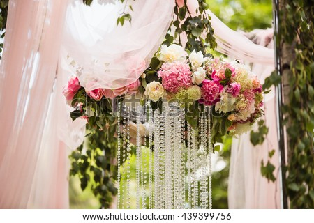 Wedding decoration ceremony (Chandelier in the arch of flowers)
