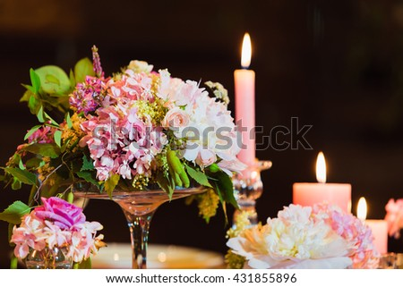 Wedding decoration in the restaurant (bouquet in a vase close) - stock photo