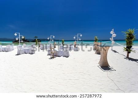 Wedding decoration on tropical beach - stock photo