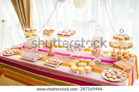 wedding decorations: macaroons, cake, muffins. Birthday party. Celebration.  - stock photo