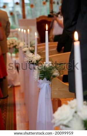 Wedding decorations of candles in the church - stock photo