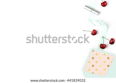Wedding desktop. Cherry and pattern. Woman desk, flat lay. Lipstick. Background mock-up. Envelope open - stock photo