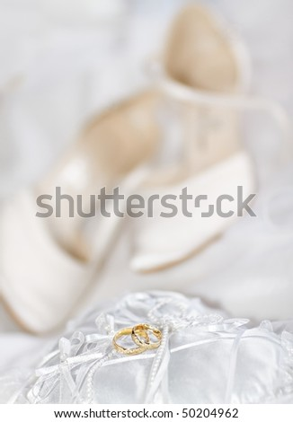 Wedding detail with beautiful golden rings and shoes - stock photo