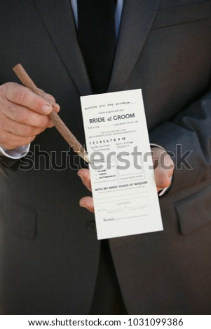 wedding details with guest holding a card for guests to fill out great idea for weddings
