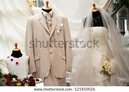 Wedding dress and suit in the store - stock photo