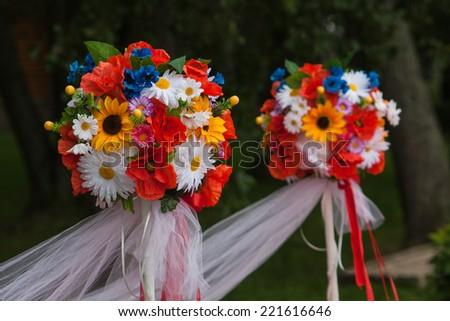 Wedding flower bouquet decorations along the aisle - stock photo