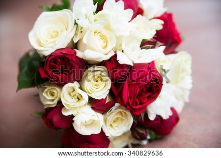 Wedding flower bouquet with pink red and white roses
