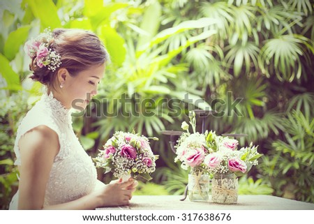 Wedding flower ,Woman holding colorful bouquet with her hands on wedding day