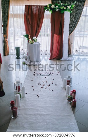 Wedding flowers and details for ceremony in marsala color - stock photo