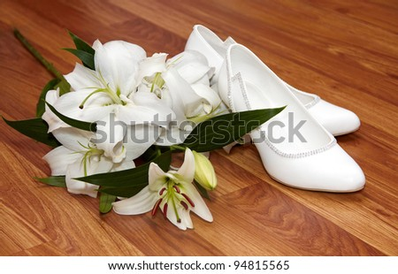 Wedding flowers and shoes on a floor - stock photo