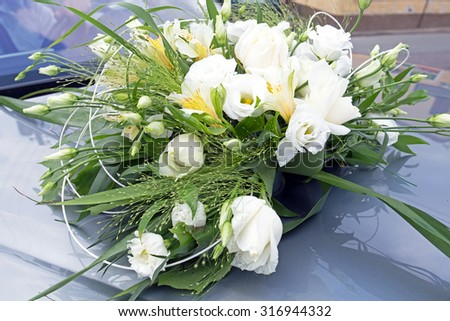 Wedding flowers bouquet close-up on the car - stock photo