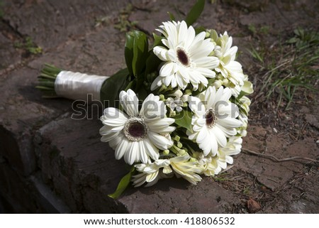 Wedding flowers bouquet with white gerbera flowers, chrysanthemums and lilies. - stock photo