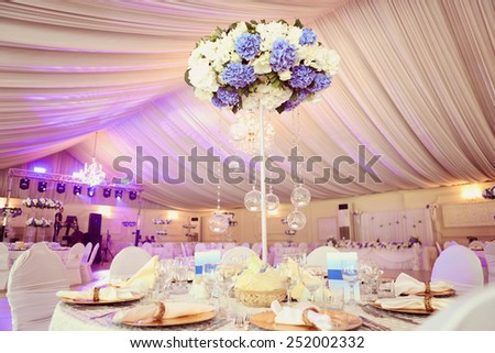 Wedding flowers decoration in the restaurant  - stock photo