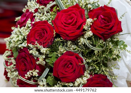 Wedding flowers from a pool of red roses.